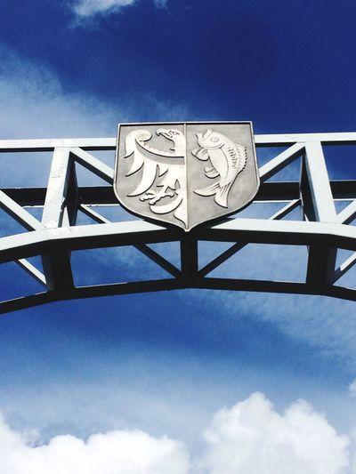 PLND. Fisherman's river. Poland Sign Coat Of Arms Bridge Eagle Fisherman Fish Badge Logo Sky Low Angle View Cloud - Sky Outdoors Architecture No People