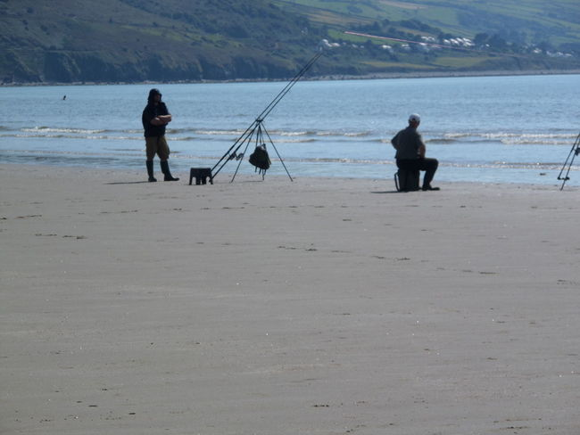 Taking Photos Fishing Man On Fairbourne Beach