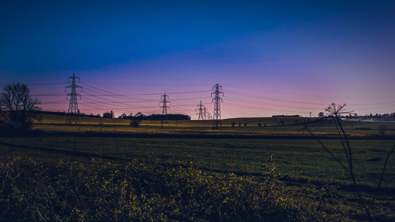 field, landscape, nature, tranquility, agriculture, no people, cable, electricity pylon, sky, blue, rural scene, beauty in nature, outdoors, clear sky, tree, day