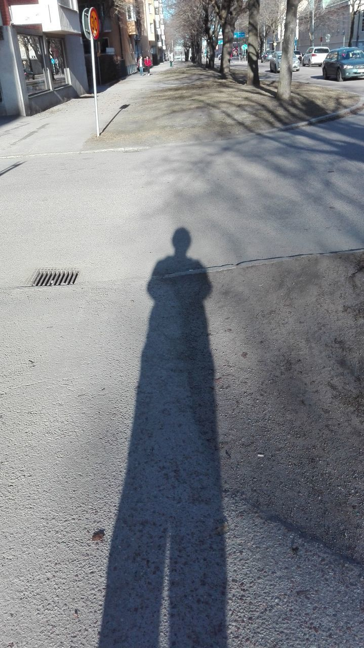 shadow, real people, sunlight, outdoors, day, men, lifestyles, one person, city, people, adult