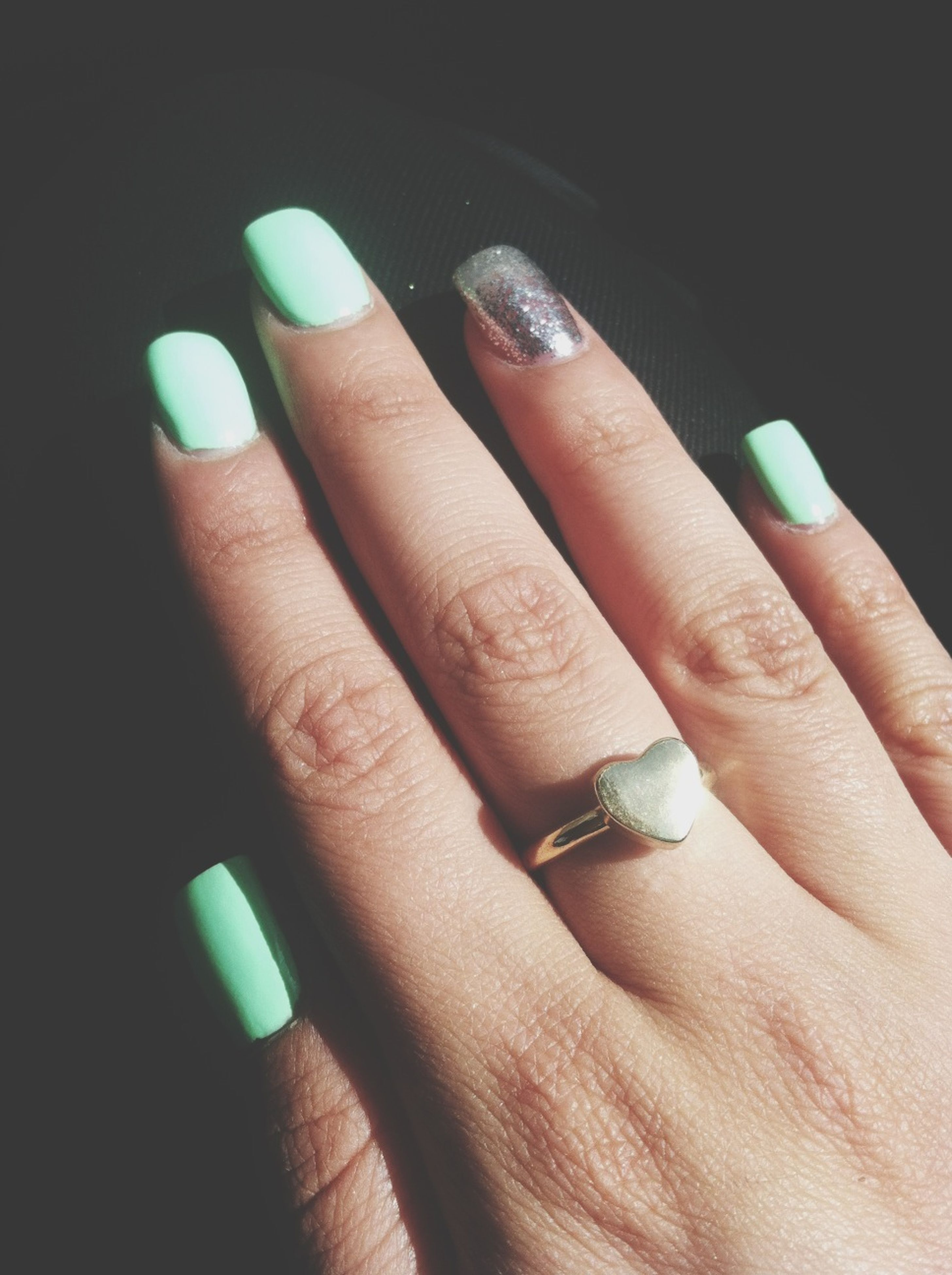 person, part of, holding, human finger, cropped, close-up, indoors, unrecognizable person, personal perspective, studio shot, lifestyles, black background, showing, nail polish, ring, leisure activity, men