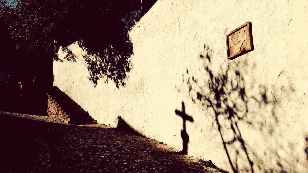 Behind this wall was where Madonna filmed 'Take a Bow' Ronda Spain Shadow Cross Historical Place City On Cliff Cliffs Historical Historical Site Historic City Outdoors Wall - Building Feature Steps And Staircases Shadows On The Wall Shadows And Silhouettes Shadows & Lights Shadows Of The World Shadow Photography EyeEm Gallery Suburban Street Photography Sight Seeing