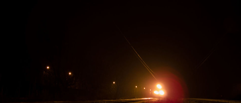 Nighttime shot of a fast moving train. Train lights in the dark. Approaching Black Blur Composition Europe Illuminated Journey Light And Shadow Light Source Moving Nature Night No People No People, Outdoors Scary Speed Spooky Train Train Station Miles Away
