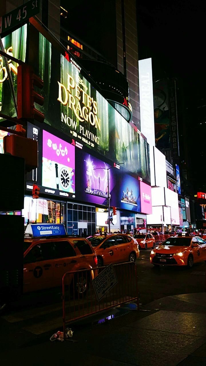 illuminated, night, car, architecture, advertisement, communication, transportation, land vehicle, travel destinations, city, building exterior, built structure, outdoors, modern, no people, neon