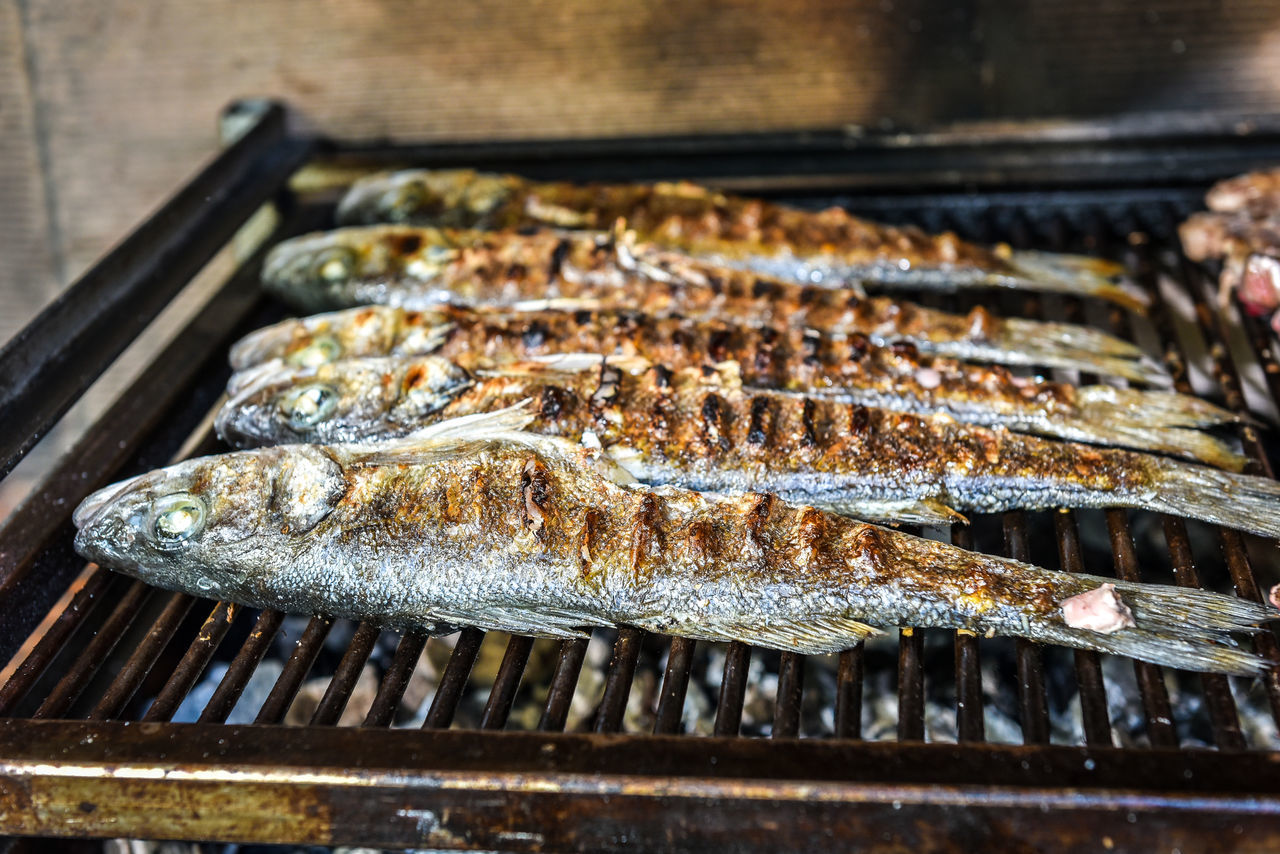 Preparing Fish on the charcoal grill. Home barbecue picnic with sea bream Backgrounds Barbecue Barbecue Grill BBQ Cevapcici Chic Close-up Day Fish Fishing Food Food And Drink Freshness Grilled Healthy Eating Hot Making Music No People Outdoors Picknik Preparing Food Seafood Sunset