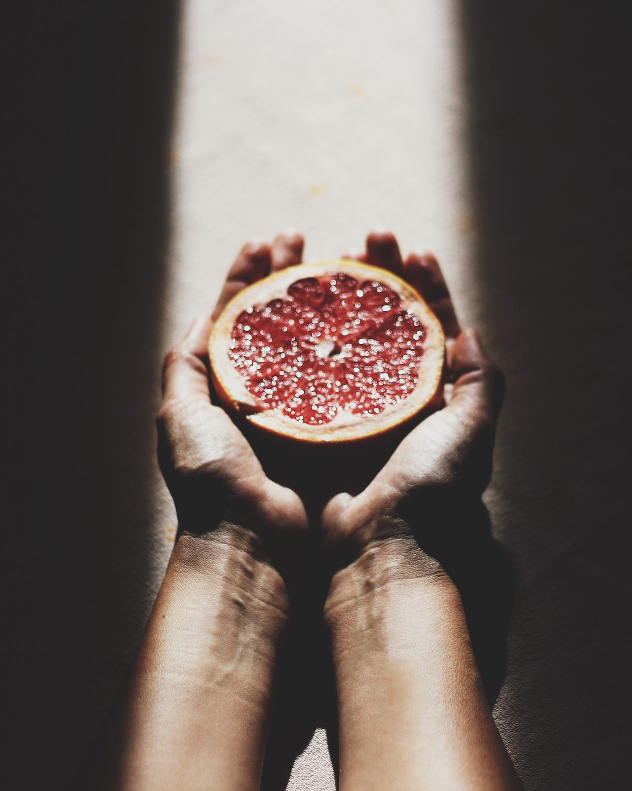 Food And Drink Food Freshness Healthy Eating One Person Real People Person Indoors  Close-up Day Eye4photography  Human Body Part Blood Orange Red SLICE Holding Freshness Pomegranate Fruit Food And Drink