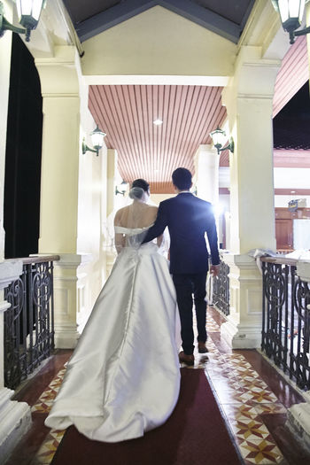 Bride Bride And Groom Bride Dress Bridegroom Day Full Length Indoors  Life Events Love People Rear View Romantic Togetherness Two People Wedding Wedding Ceremony Wedding Ceremony-thai Style Wedding Day Wedding Dress Wedding Dresses Wedding Party Wedding Photography Wedding Photos Young Adult Young Women