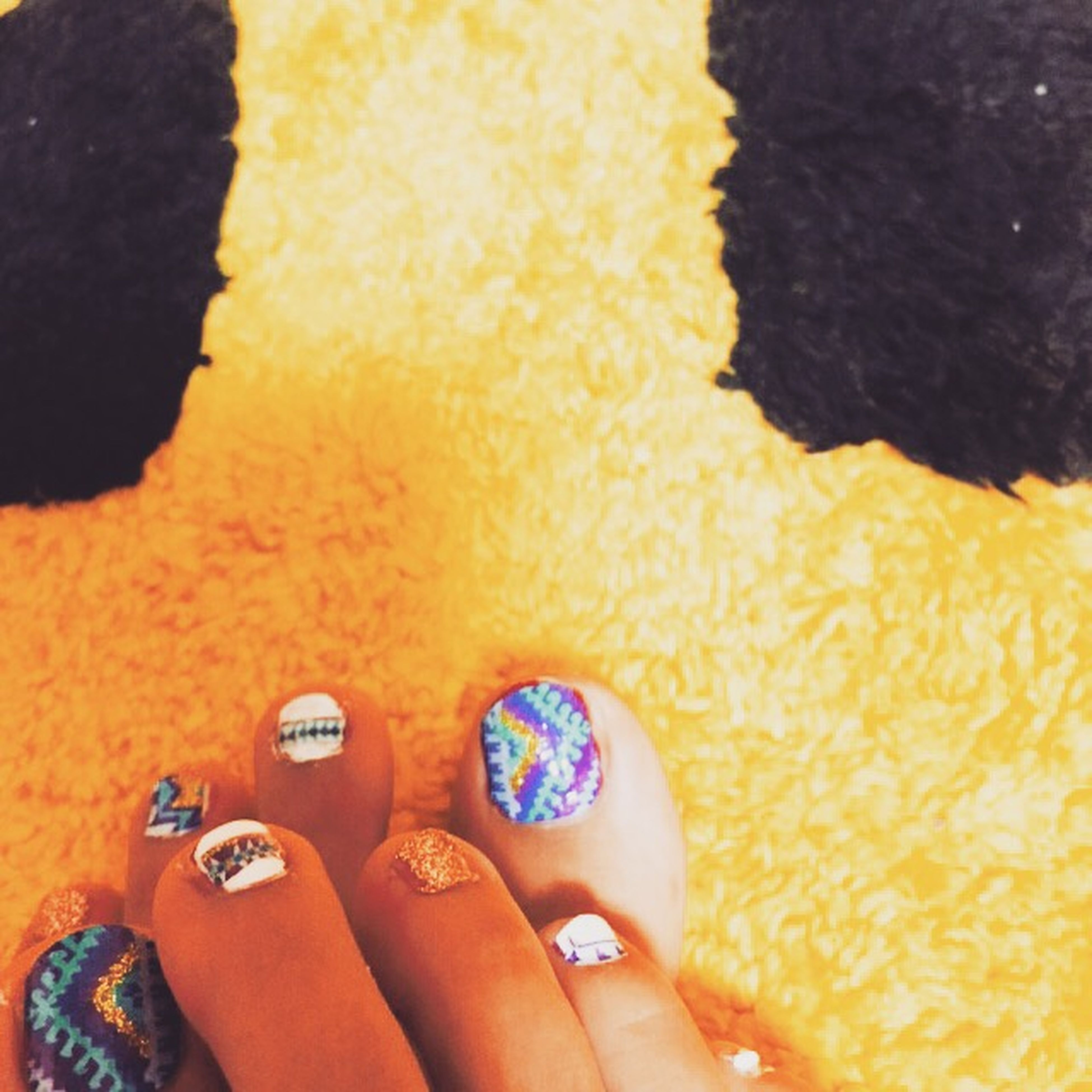lifestyles, yellow, leisure activity, person, part of, personal perspective, indoors, holding, close-up, high angle view, unrecognizable person, nail polish, orange color, cropped, men, childhood