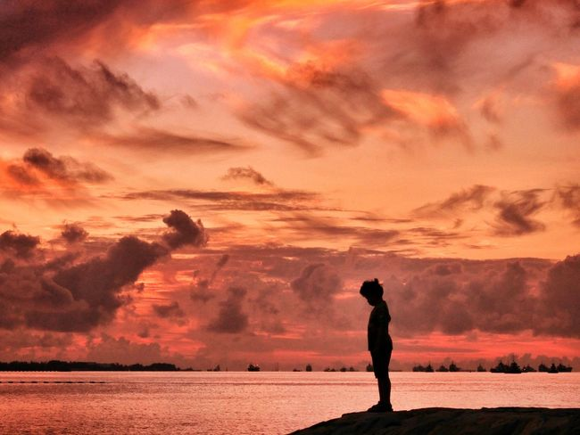 Another shot of my son with the awesome Sunrise, this time he is just standing over the horizon... Cloudporn Clouds Clouds And Sky Sunrise Sunrise_sunsets_aroundworld Sunrise_Collection Sunset Sunset_collection Sunset Silhouettes Silhouette