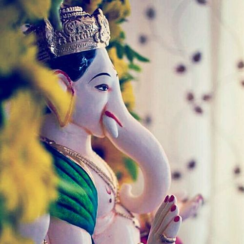 """"""" ReligionGanpati Bappa """" Art And Craft Human Representation Indoors  Focus On Foreground Selective Focus Spirituality Statue Close-up Art Text Man Made Object Creativity Day Culture Symbol Retail  First Eyeem Photo"""