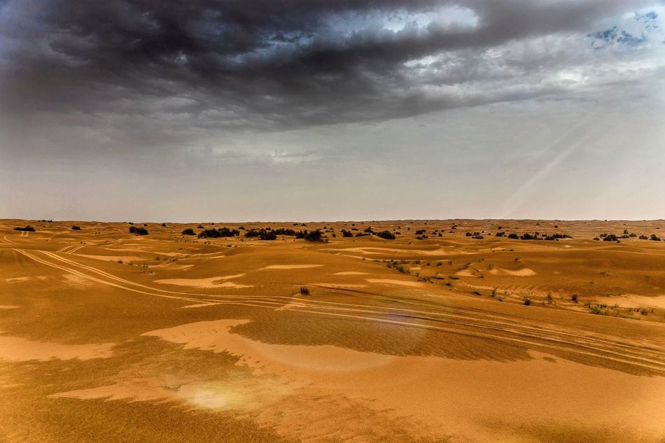 Desert Sky Sand Dramatic Sky Landscape Nature Sand Dune Outdoors Beauty In Nature Scenics Sunset No People Arid Climate Day