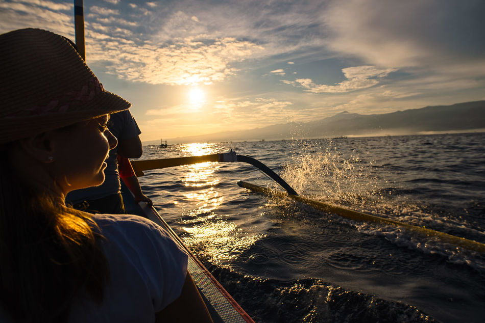Dolphin spotting Bali Boat INDONESIA Jukung Nature One Person Sea Sunrise Travel Woman
