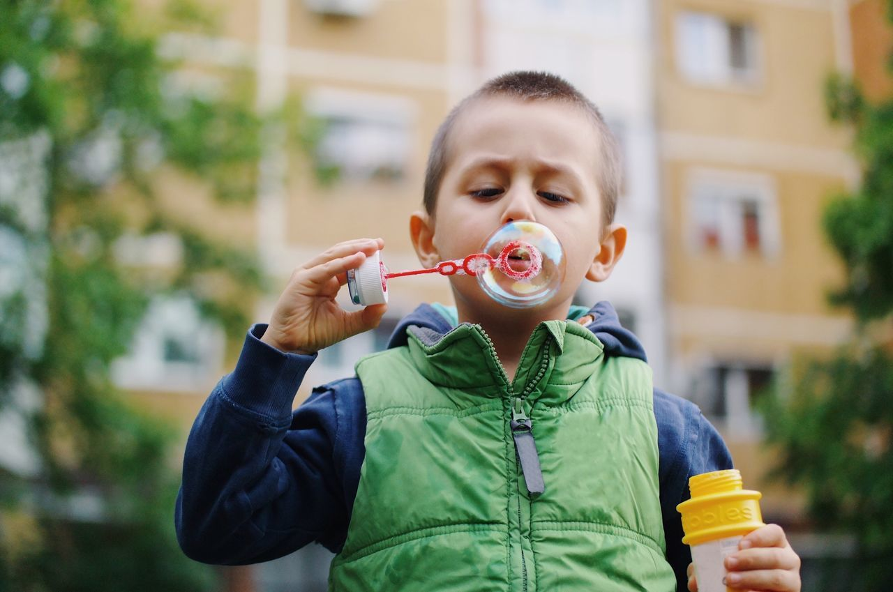 Bubble creation... Childhood Blowing Bubble Wand Front View Bubble Boys Holding Casual Clothing Leisure Activity Happiness Lifestyles Child Kid Kids Being Kids Details Of My Life My Favorite Photo VSCO Made In Romania Bubbles City Life City City Street Portrait Kids Playing Playtime