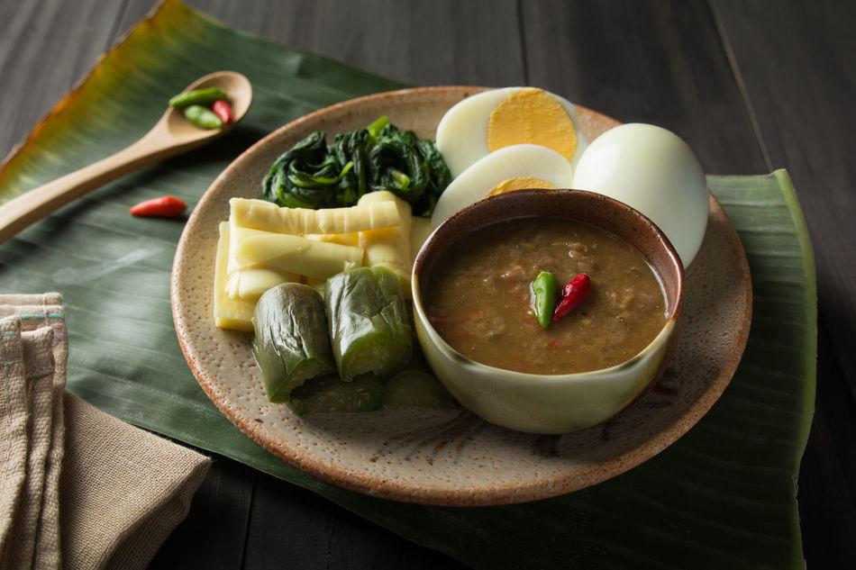 Bamboo Shoots Banana Leaf Boiled Eggs Bowl Chili  Cilantro Close-up Day Delicious Eggplants Eggs Food Food Stylist Freshness Healthy Eating Indoors  Morning Glory Namprik Pra-ra No People Ready-to-eat SLICE Thai Food Good Taste Thai Foods Vegetables Wood - Material