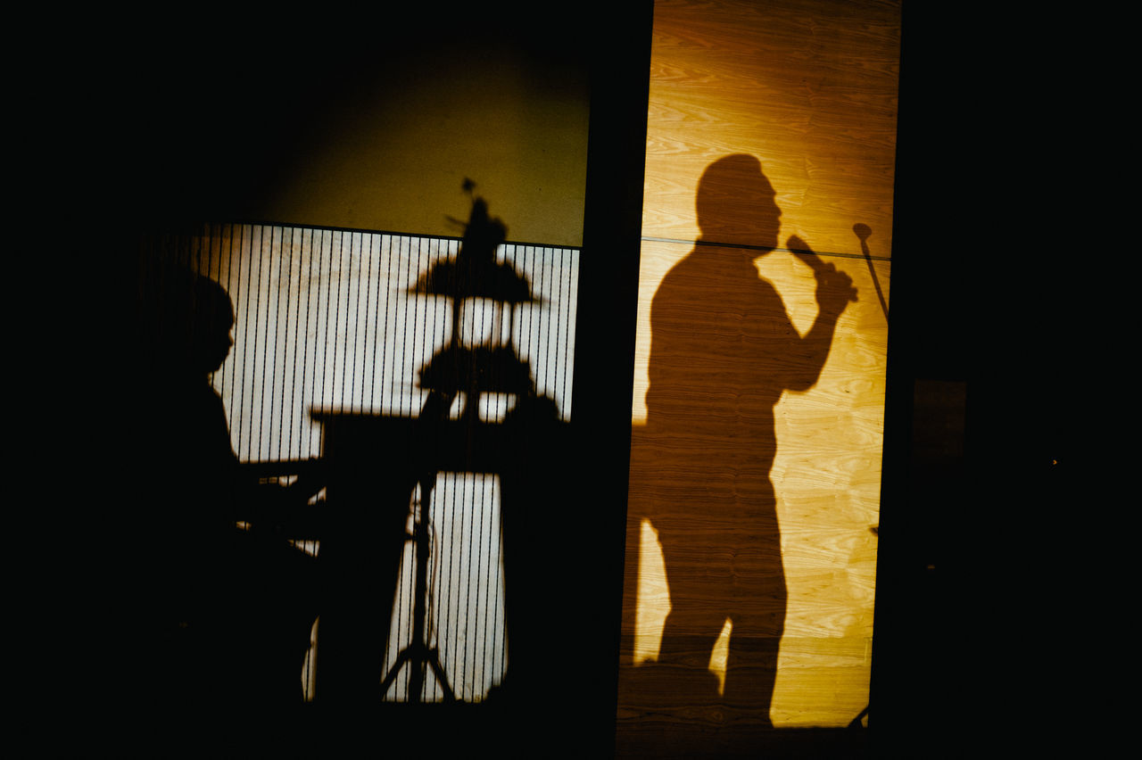 Shadow Of Musicians On Wall