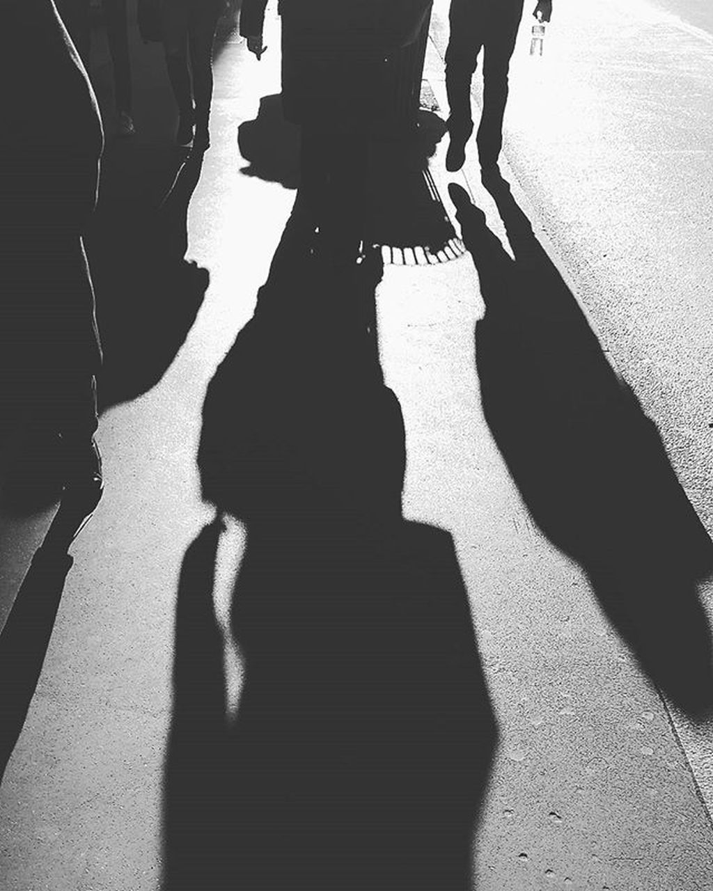 shadow, sunlight, real people, focus on shadow, day, silhouette, women, men, togetherness, low section, lifestyles, outdoors, adult, people
