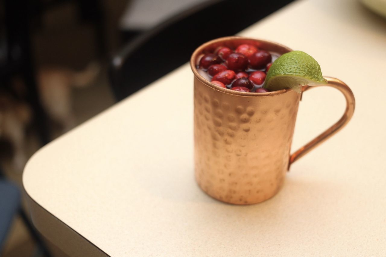 Festive Holiday Moscow Mule with Cranberry and Lime Alcoholic Beverage Copper Mug Crane Fewtiv Food Food And Drink Freshness Fruit Indoors  Moscow Mule No People Table