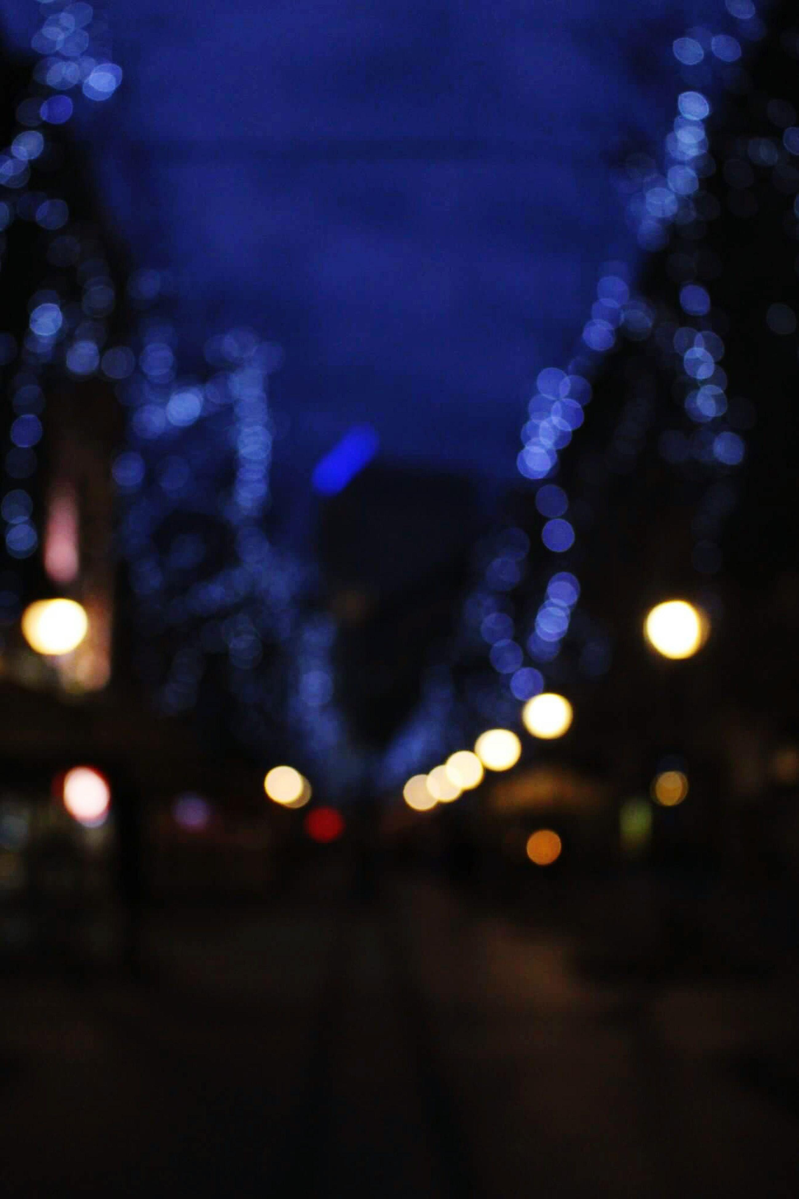 illuminated, night, defocused, lighting equipment, light - natural phenomenon, city, street, building exterior, glowing, street light, sky, no people, road, dusk, car, outdoors, architecture, transportation, water, light