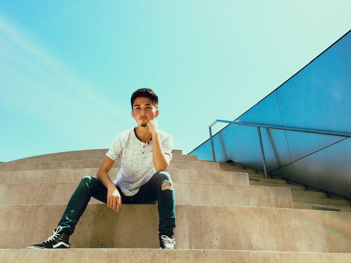 Wassup? Full Length Clear Sky Young Adult Casual Clothing Railing F4F Street Photography DTLA EyeEm Best Shots Playing Streetphotography Leisure Activity Lifestyles Blue Built Structure Portrait Looking At Camera Connection Person Person Day Bridge - Man Made Structure Front View Confidence  Sky