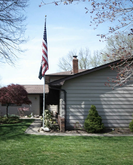 Morning walk through the neighborhood Residential  Mid Century Architecture American Flag