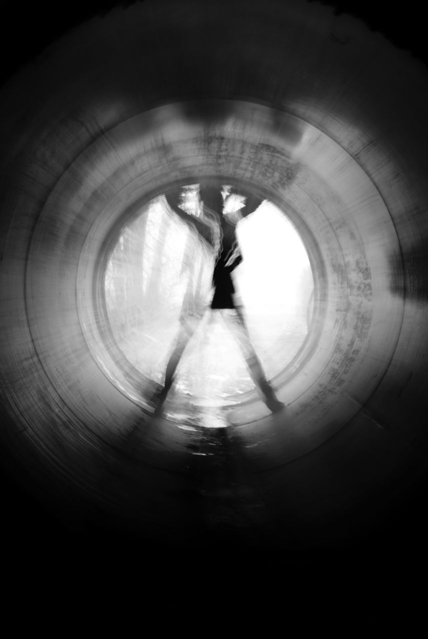 Blurred Motion Of Person Standing In Tunnel