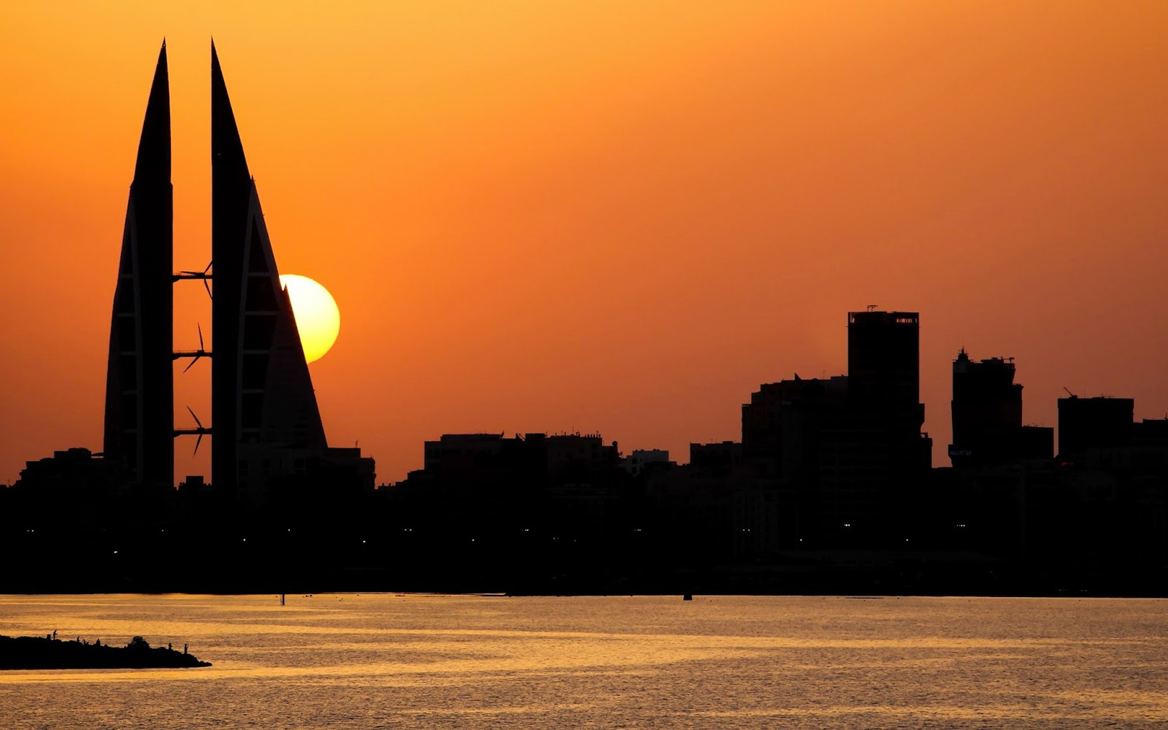 sunset, architecture, built structure, building exterior, orange color, silhouette, clear sky, city, water, copy space, waterfront, river, sky, tower, urban skyline, cityscape, outdoors, skyscraper, sea, dusk