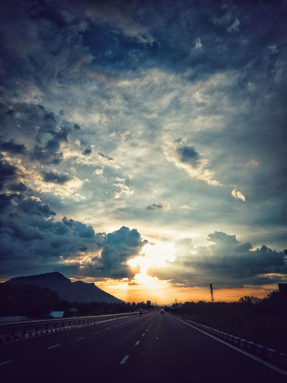 Weekend Love Beauty In Nature Cloud Cloud - Sky Cloudscape Cloudy Country Road Day Diminishing Perspective Long Majestic Mountain Nature Outdoors Remote Road Scenics Sky Solitude Sun Sunset The Way Forward Tranquil Scene Tranquility Transportation Vanishing Point
