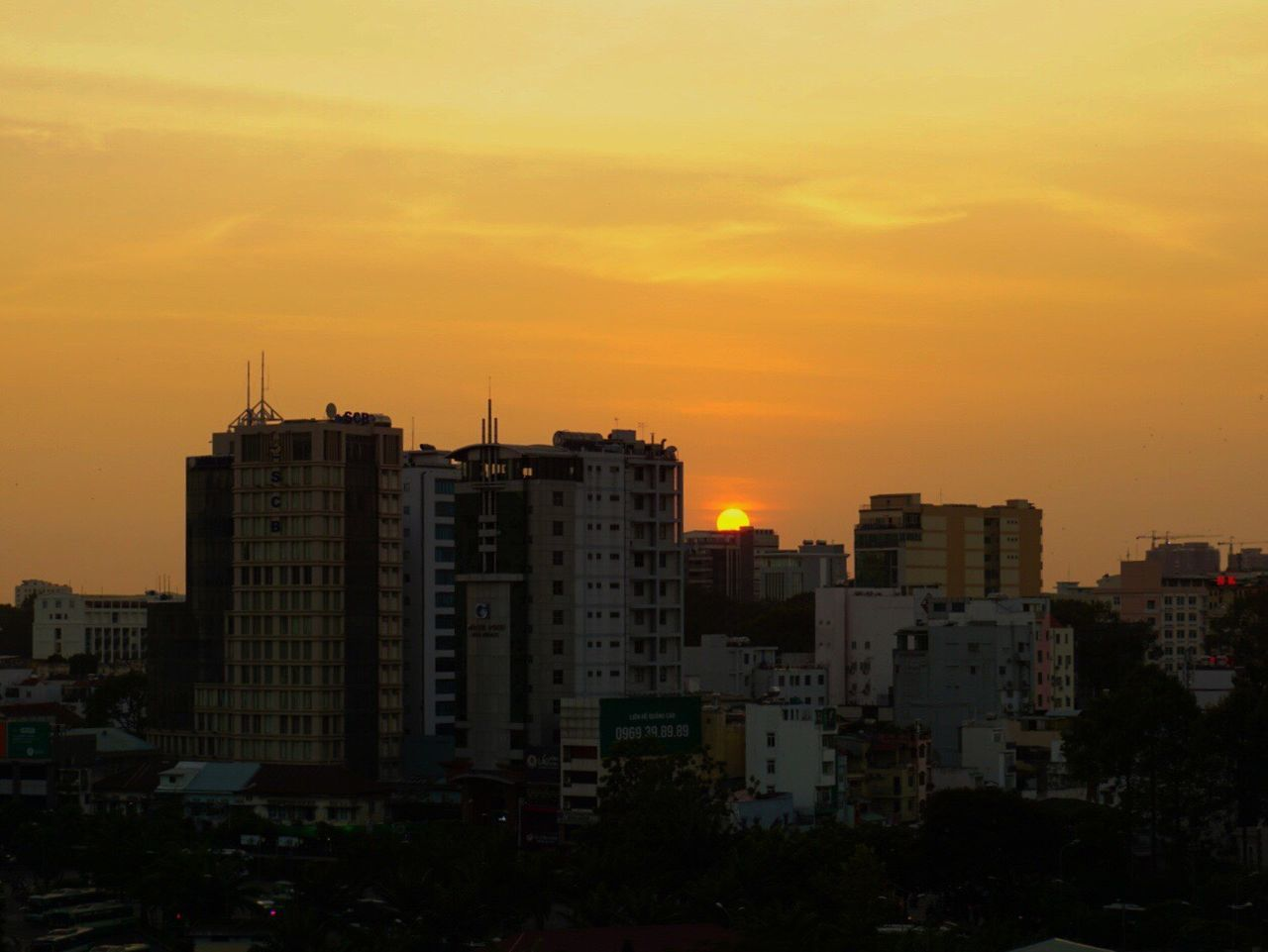 Sun setting over Saigon Building Exterior City Sunset Orange Color No People Skyscraper Visitvietnam City Life Saigon Hochiminhcity Vietnam Discovervietnam Travel Destinations