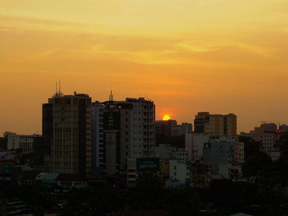 Sun setting over Saigon Building Exterior City Sunset Orange Color No People Skyscraper Visitvietnam City Life Saigon Hochiminhcity Vietnam Discovervietnam Travel Destinations