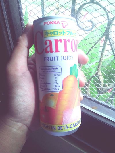 One Person Close-up Human Hand Human Body Part Juice In Can Carrot Juice