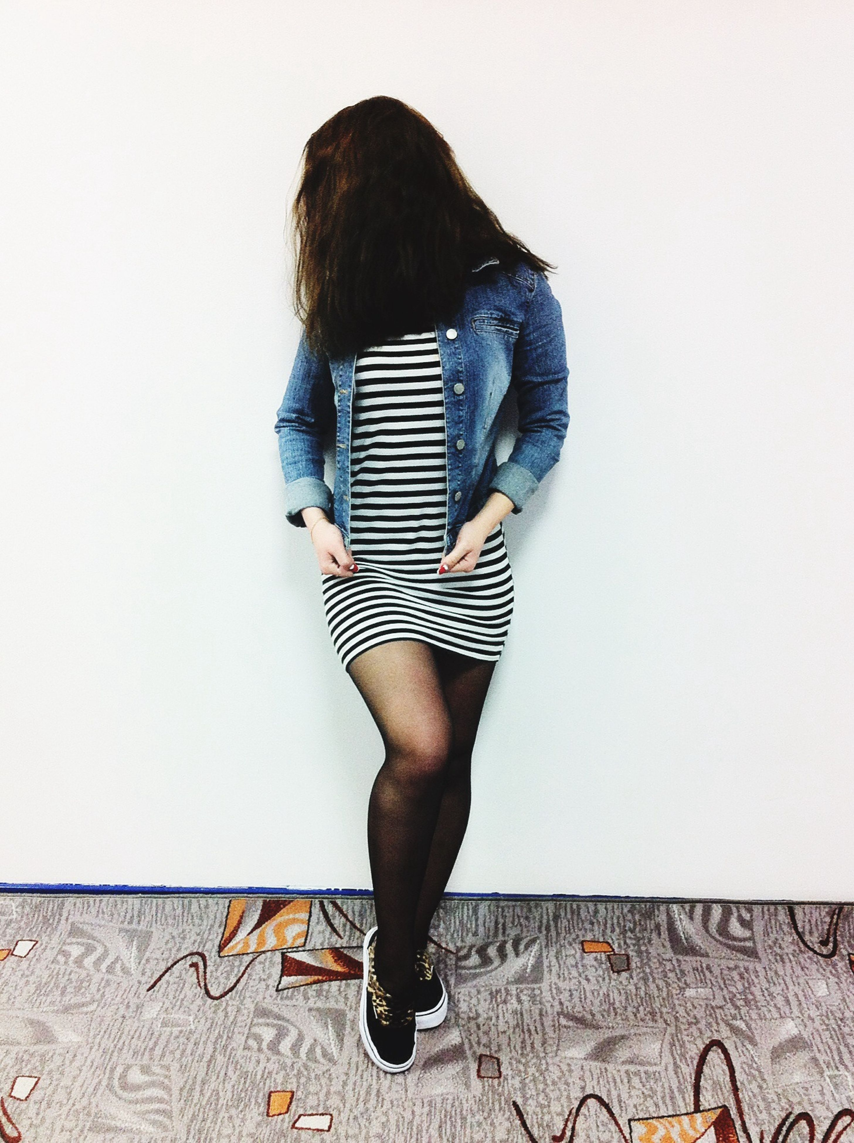 lifestyles, young adult, young women, casual clothing, standing, leisure activity, full length, wall - building feature, long hair, person, three quarter length, front view, fashion, rear view, side view, sensuality