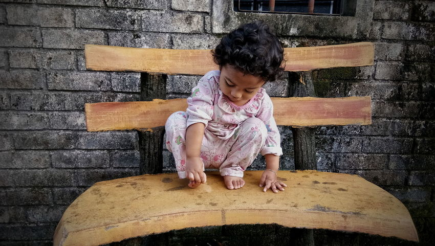 Concrete Chairs One Person Girls Real People Child Outdoors Looking Down Concrete Structure The Week On EyeEm