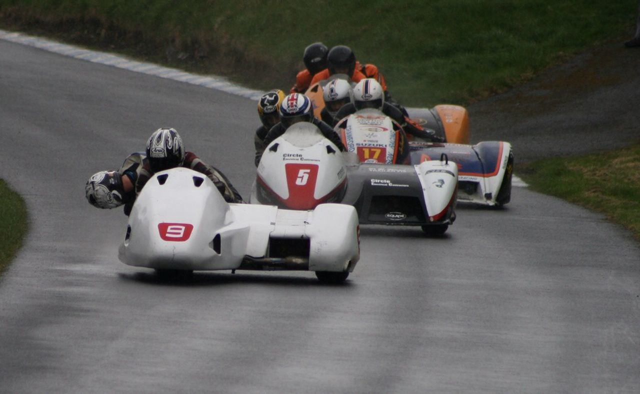 sports race, speed, sport, motorsport, competition, auto racing, crash helmet, racecar, professional sport, group of people, real people, sports clothing, sports track, competitive sport, teamwork, sports team, day, outdoors, finish line, people