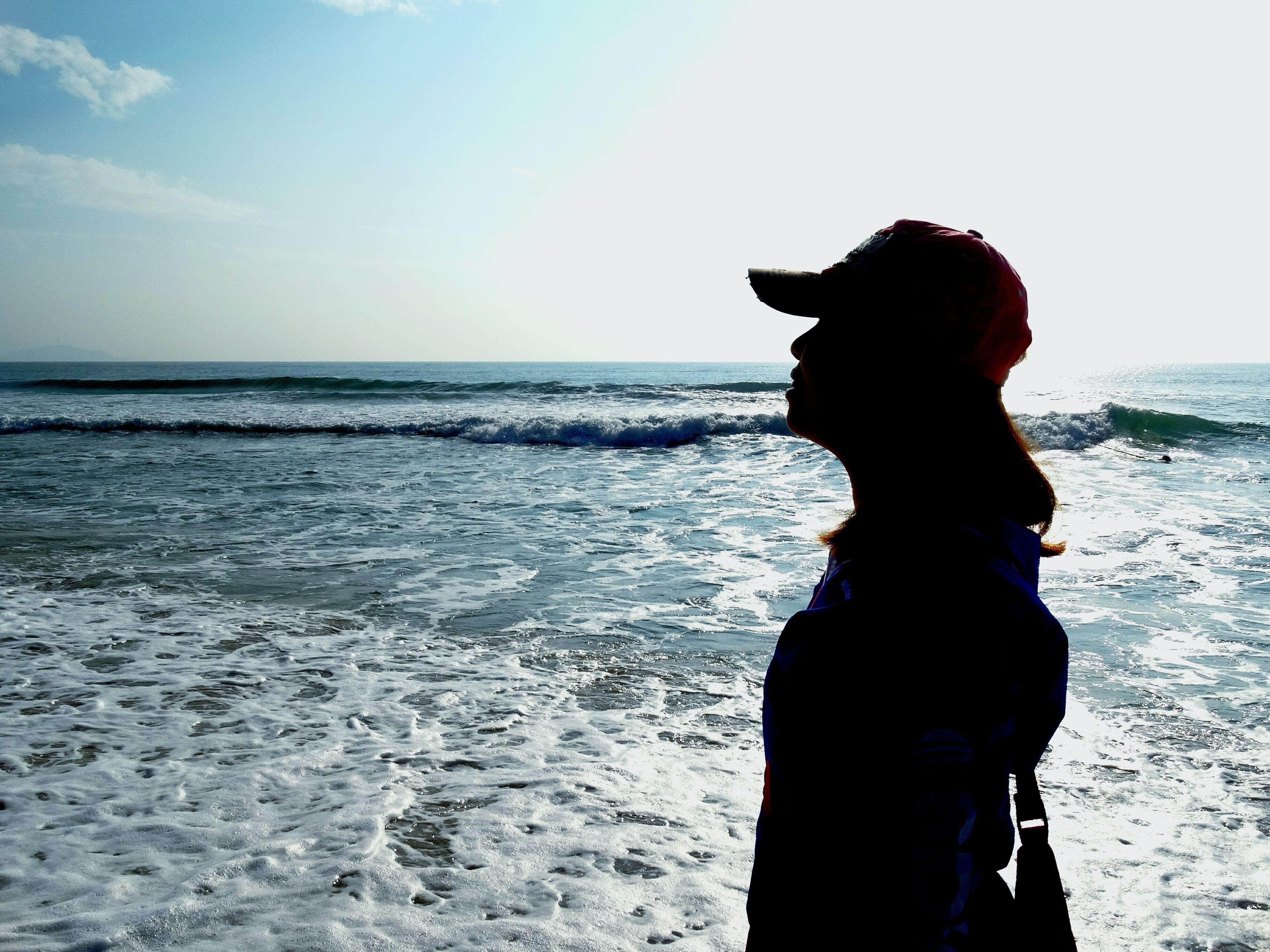 sea, horizon over water, water, standing, lifestyles, sky, leisure activity, beach, three quarter length, rear view, scenics, waist up, shore, young adult, tranquil scene, casual clothing, tranquility, nature