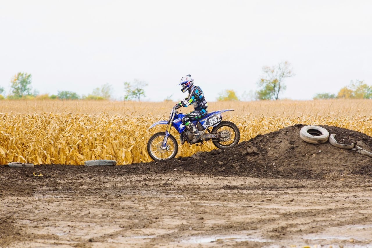 Field Transportation Rural Scene Day One Person Outdoors Adventure Motocross Headwear People Sports Sports Photography Sky Nature One Man Only Only Men Fun Dirt Motorcycle Gear
