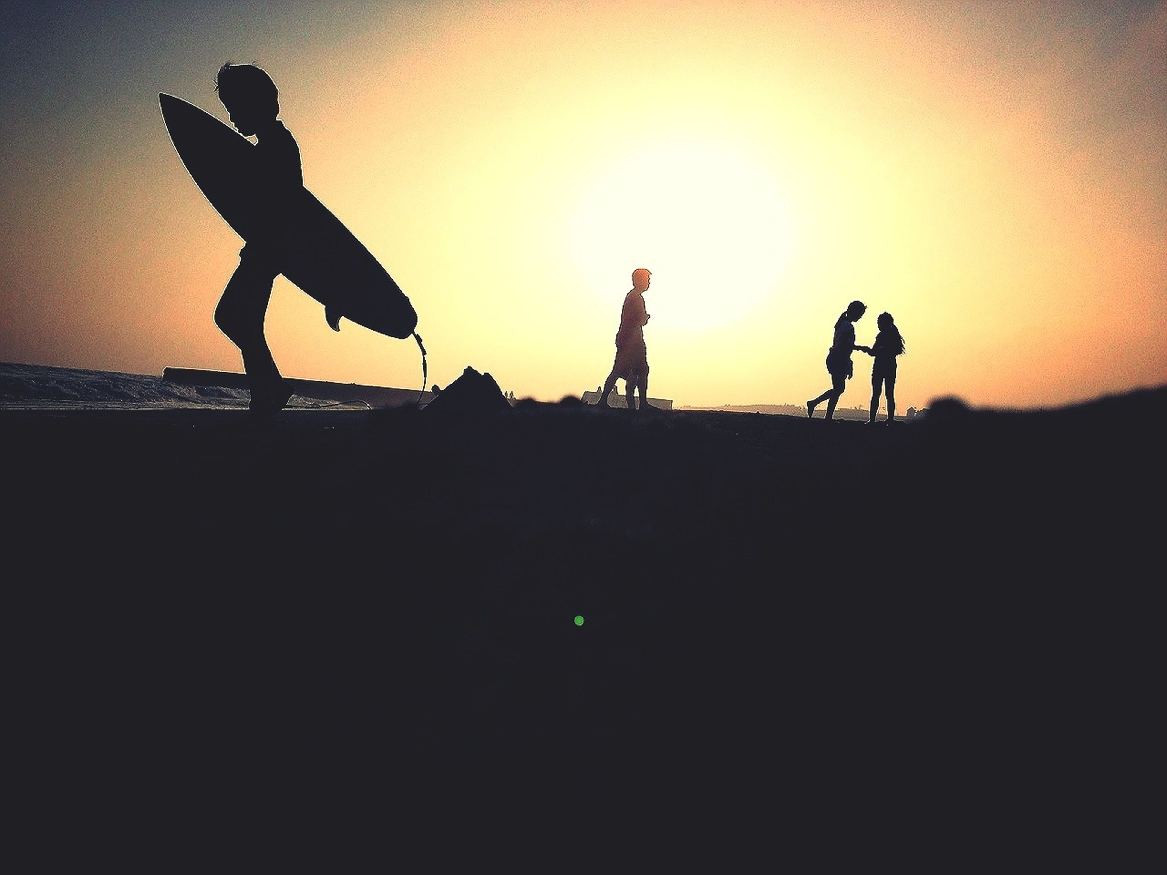 silhouette, sunset, orange color, sky, men, copy space, lifestyles, full length, mid-air, leisure activity, outline, dusk, standing, clear sky, low angle view, outdoors, sun, nature