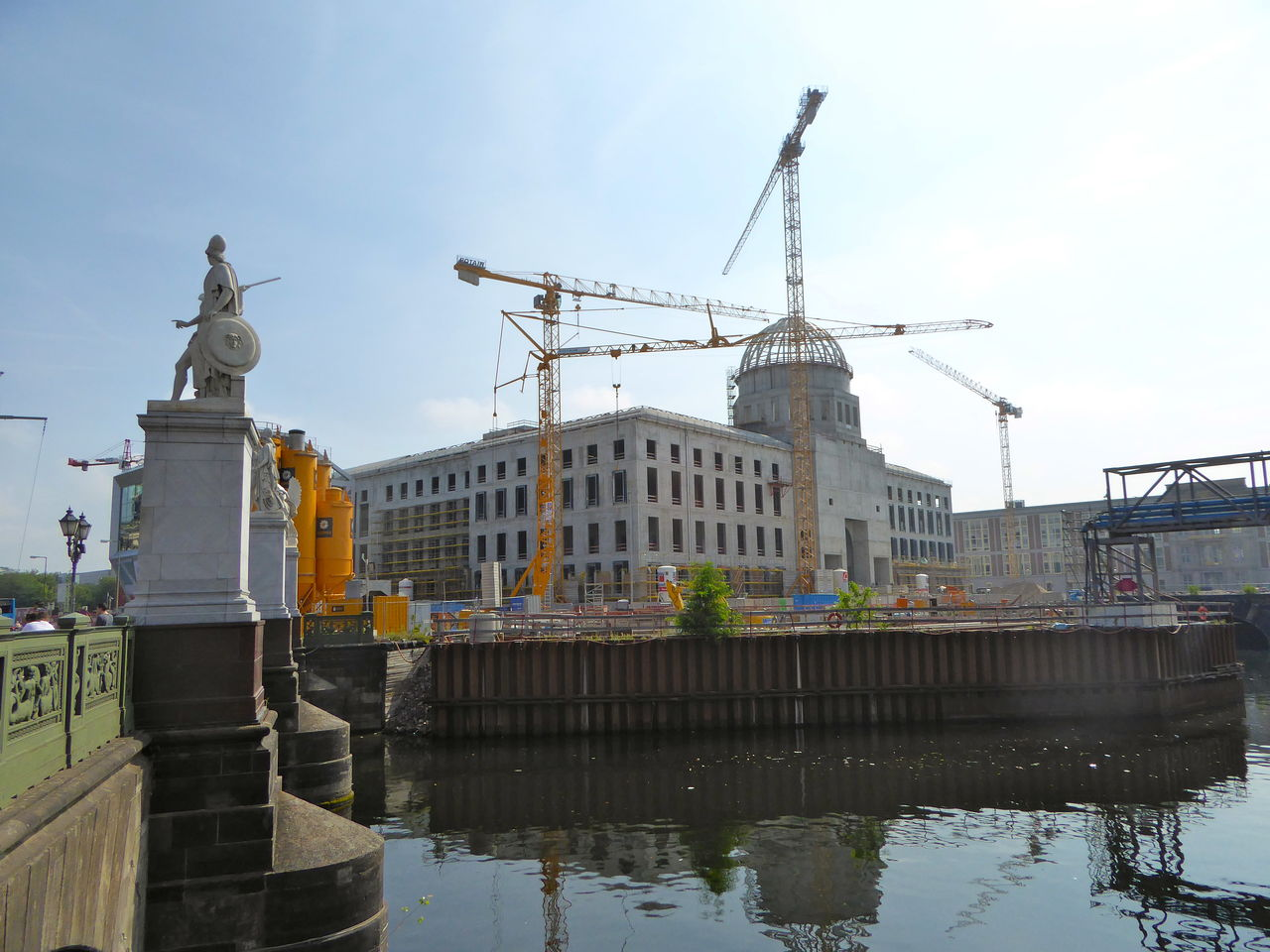 Architecture Being Built Berliner Schloss Concrete Cranes And Construction Greek Statue In Berlin, New Ethnological Museum New Humboldt Forum Reconstruction Of Berlins City Palace Reflections In The Water Sky Water