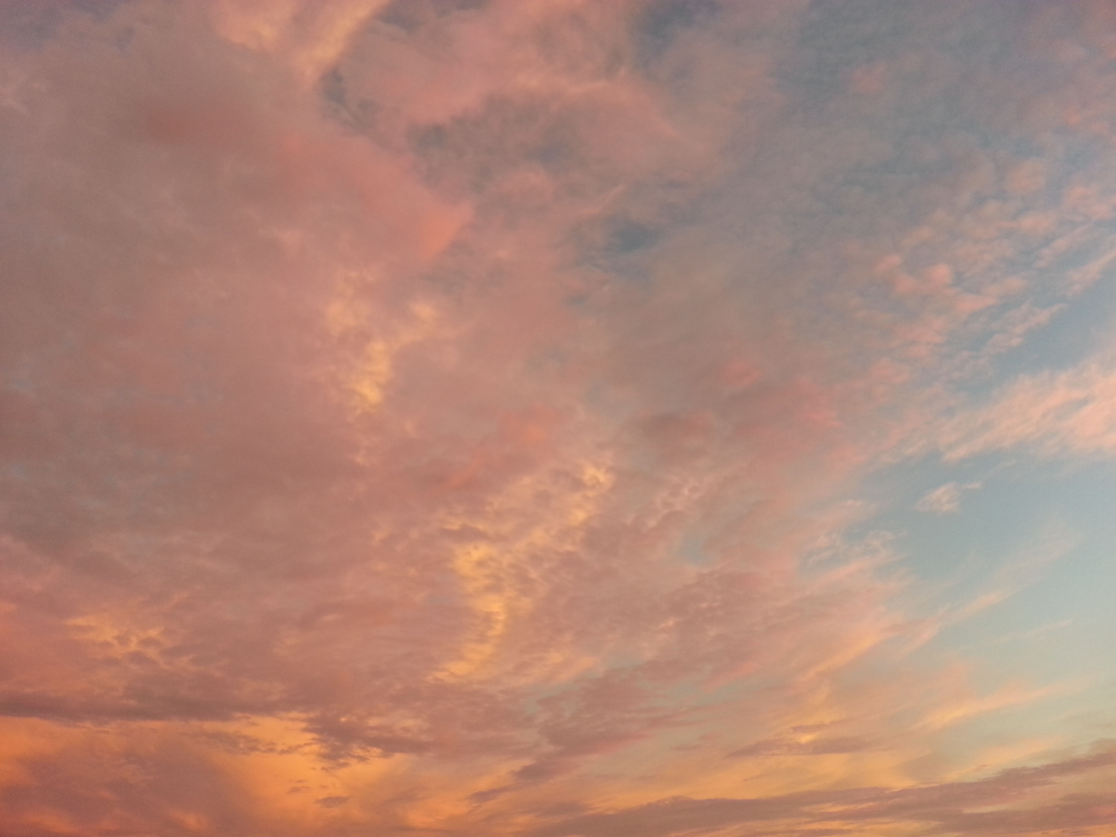 sky, sunset, cloud - sky, low angle view, beauty in nature, tranquility, scenics, orange color, cloudy, tranquil scene, backgrounds, nature, sky only, idyllic, full frame, cloudscape, cloud, dramatic sky, outdoors, no people