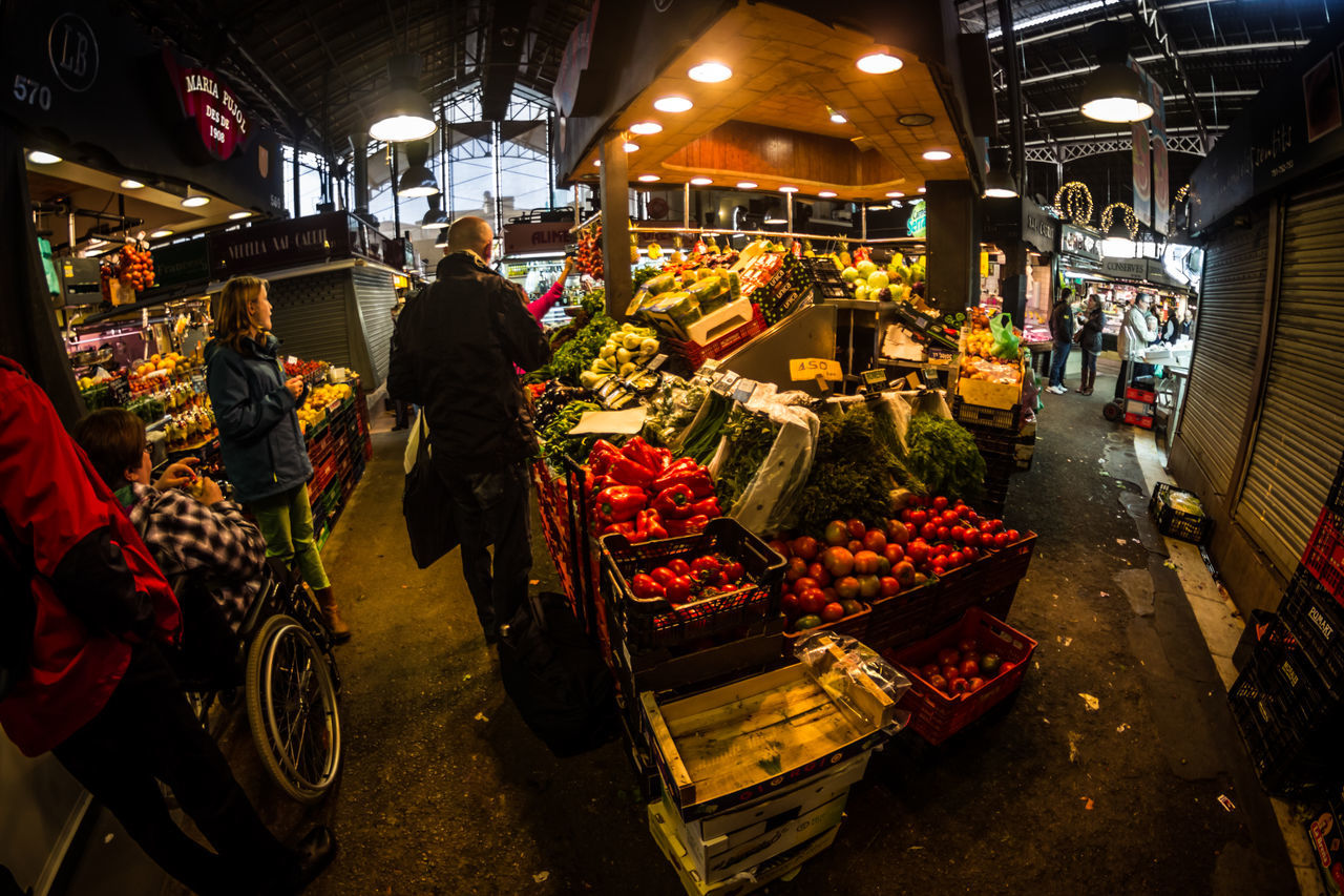 market, real people, retail, market stall, for sale, men, vegetable, buying, food, illuminated, lifestyles, customer, night, large group of people, land vehicle, women, choice, farmer market, built structure, healthy eating, occupation, motorcycle, architecture, freshness, outdoors, city, people
