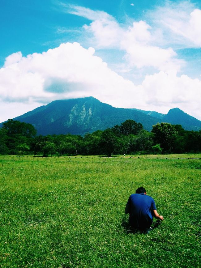 Looking for something Mountain Relaxation Sitting Rear View Leisure Activity Men Grass Lifestyles Mountain Range Solitude Casual Clothing Person Tranquil Scene Sky Tranquility Green Color Scenics Day Cloud - Sky Beauty In Nature Visitindonesia Indonesia_photography