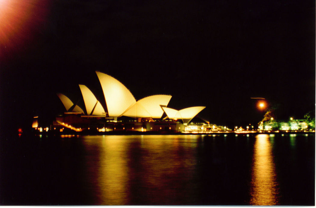 Architecture.  Australia. Built Structure Copy Space Dark Famous Place. Glowing Illuminated Night No People Outdoors Reflection Sea Sky Sydney Opera House. Sydney. Tranquil Scene Tranquility Water Waterfront