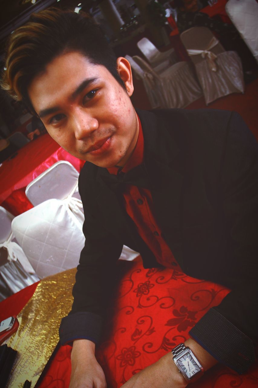 looking at camera, one person, portrait, high angle view, smiling, food and drink, indoors, happiness, real people, young adult, night, food, one man only, people