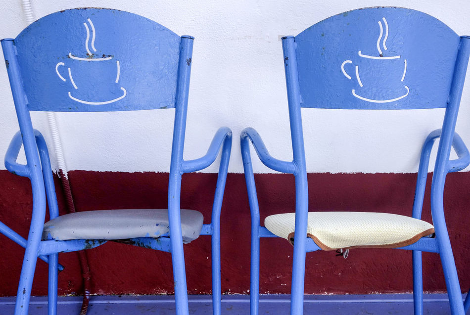 Cafe Bar Chairs, Sigri, Lesvos, Greece Blue Chair Chairs Close-up Coffee Cups Coffee Time Colourful Day Graphic Greece Lesbos Lesvos Greece Metal Chairs No People Outdoors Seating Symetry Travel Photography Two Of A Kind Two Things