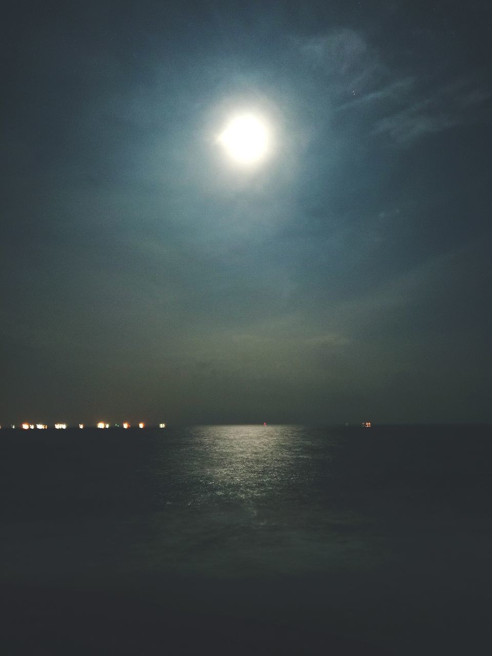 moon, sun, illuminated, water, scenics, sky, beauty in nature, nature, tranquility, no people, outdoors, tranquil scene, moonlight, sea, astronomy