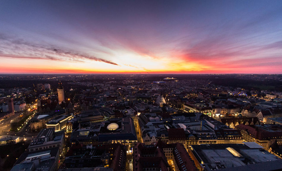 Cityscape Sunset City Skyscraper Travel Destinations Urban Skyline Dramatic Sky Architecture Dusk Building Exterior Outdoors Aerial View Cloud - Sky City Life Illuminated No People Sky Awe Built Structure Night Silhouette_collection Silhouette Photography Leipzigcity Leipzigram Leipzig