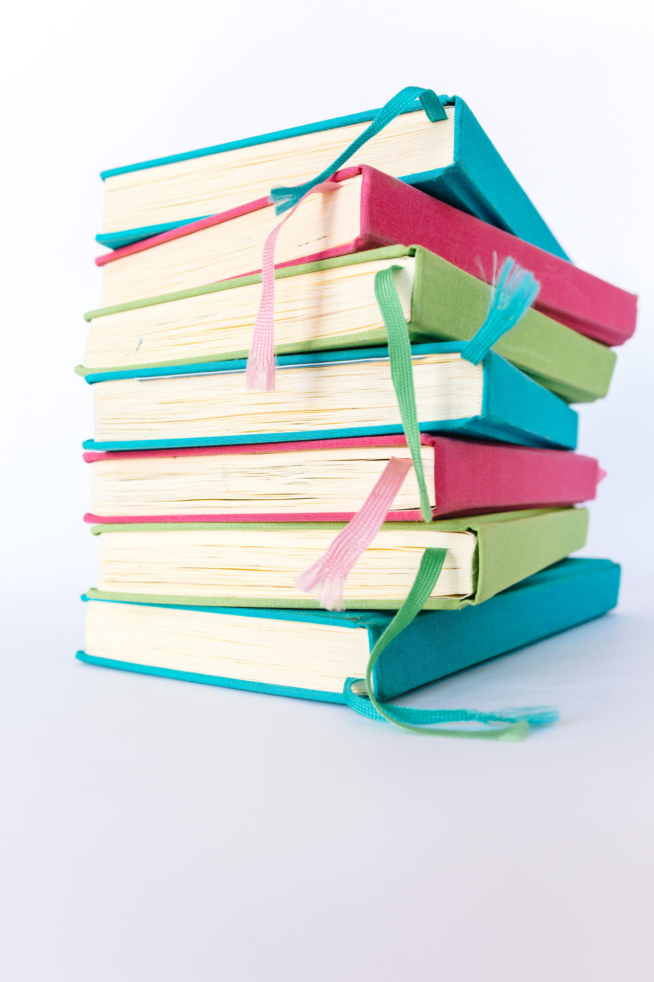 Colorful Books Blue Books Colorful Colors Cyan Education Educational Green Learning LearningEveryday Multi Colored No People Office Supply Paper Pink Reading Reading Books Reading Time Stack Study Hard Study Time Studying White Background