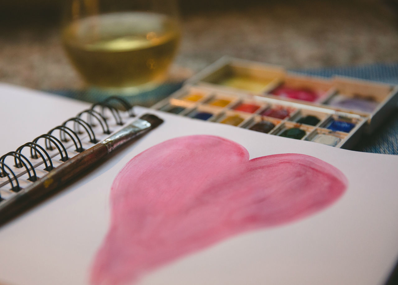 Heart painted in a journal with a glass of wine Brush Heart Hobby Indoors  Landscape No People Painting Pallette Pink Color Relaz Still Life Table Valentines Day Winter