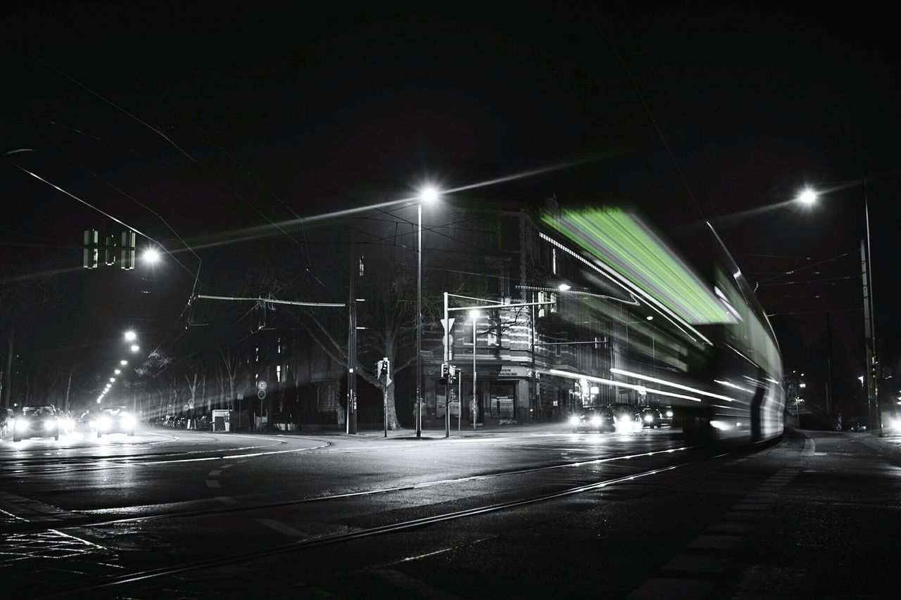 ~ 🚊✴~ Night Illuminated Street Light No People City Outdoors Sky Long Exposure Traffic Black & White Road Night Photography Speed Light And Shadow Getting Inspired Transportation Motion Canon Light Trail Urban Exploration Velocity Nightphotography Streetphotography Architecture Colorsplash