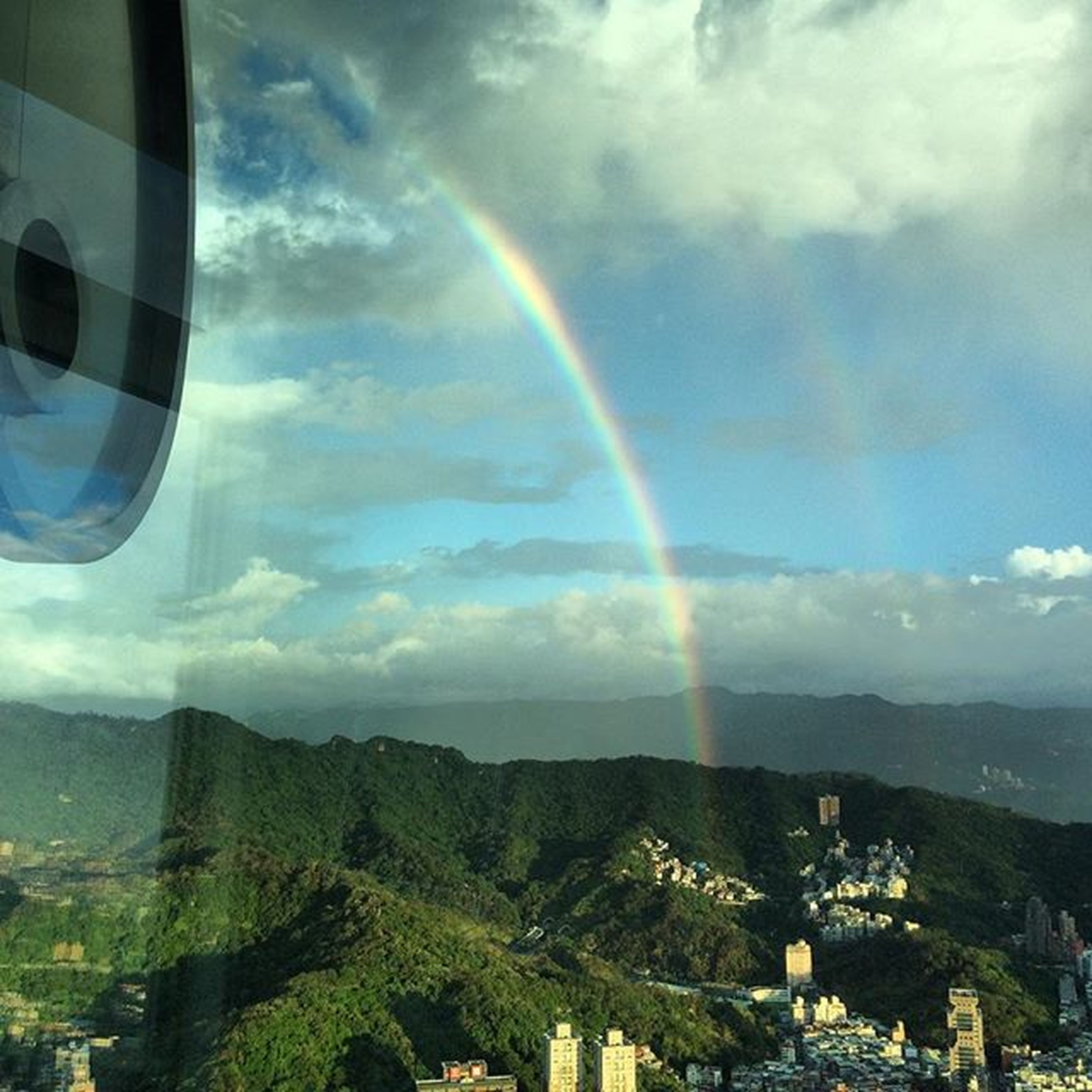 rainbow, sky, cloud - sky, scenics, beauty in nature, landscape, mountain, building exterior, architecture, built structure, nature, cloudy, cloud, tranquil scene, multi colored, tranquility, idyllic, house, weather, aerial view
