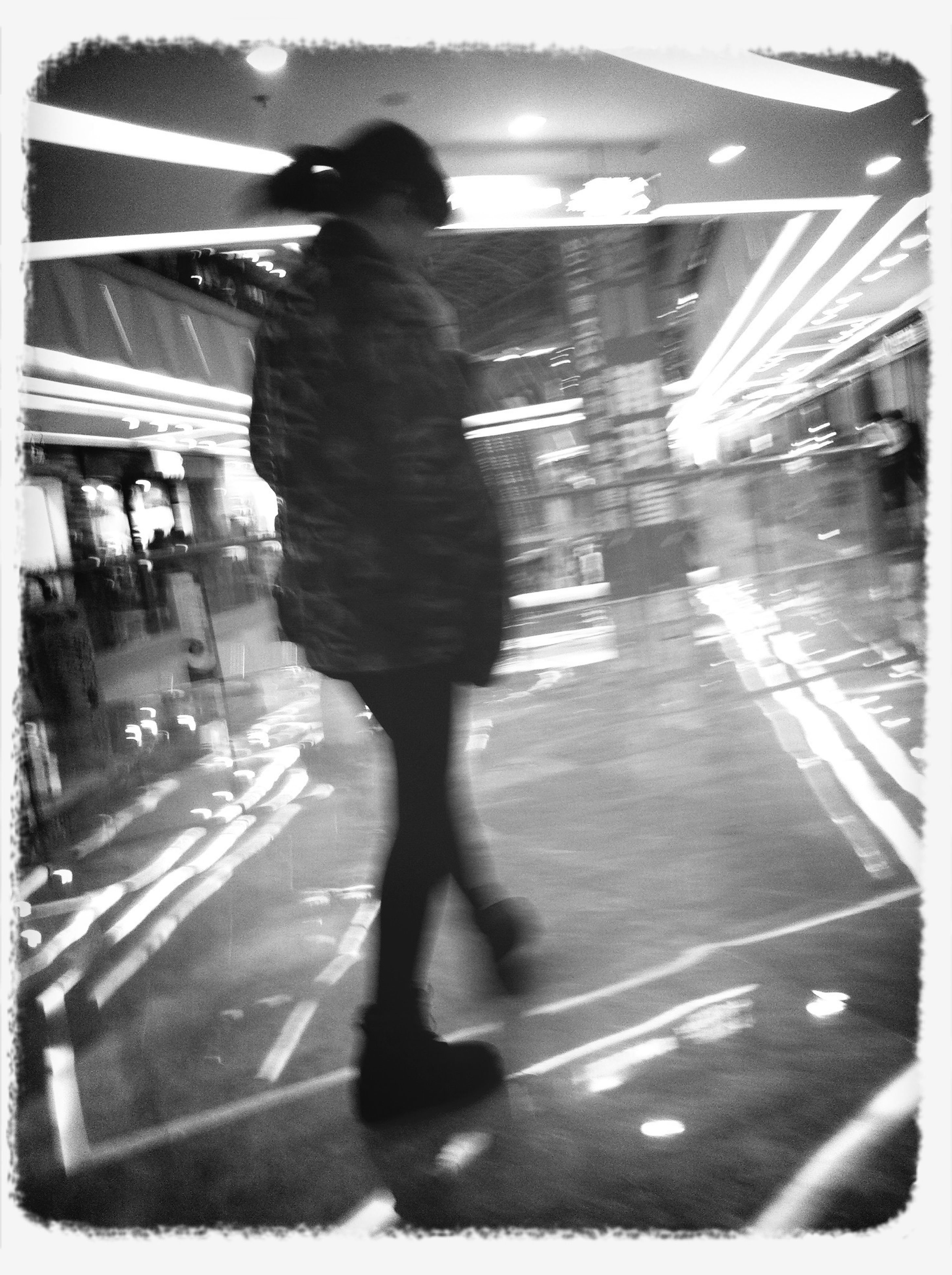 transfer print, auto post production filter, lifestyles, street, full length, walking, night, leisure activity, city life, person, standing, men, transportation, road, shadow, blurred motion, city, indoors